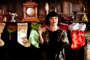 """This photo provided by Acorn TV shows, Essie Davis as Phryne Fisher in the episode """"Murder Under the Mistletoe"""" of series 2 """"Miss Fisher's Murder Mysteries,"""" on Acorn TV. A monthly subscription to a streaming site is the gift that keeps on giving. (Acorn TV via AP)"""