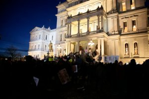 Protesters gather outside the state Capitol before Michigan Gov. Rick Snyder's State of the State address, Tuesday, Jan. 19, 2016, in Lansing, Mich. With the water crisis gripping Flint threatening to overshadow nearly everything else he has accomplished, the Republican governor again pledged a fix Tuesday night during his annual State of the State speech. (AP Photo/Al Goldis)