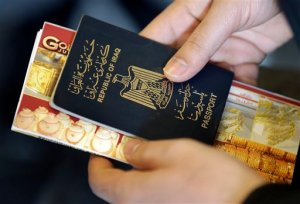 In this Jan. 26, 2016 photo Hussein Hotuman from Iraq, holds his travel documents at the 'Golf Reisen' (Gulf Travels) travel agency of Alaa Hadrous in Berlin, Germany. Homesick and tired of waiting for Germany's backlogged bureaucracy, a steady stream of Iraqis are heading home on their own. (AP Photo/Michael Sohn)