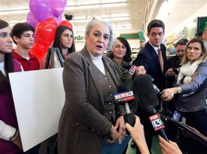 Rebecca Hargrove, center, president & CEO of the Tennessee Lottery, makes the announcement at Naifeh's supermarket in Munford, Tenn., Thursday, Jan. 14, 2016, that the store sold one of three winning tickets in the record Powerball jackpot. The holder of the winning ticket will share the $1.6 billion jackpot with winners in Southern California and Florida. (AP Photo/Karen Pulfer Focht)