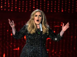 "FILE - In this Feb. 24, 2013 file photo, singer Adele performs during the Oscars at the Dolby Theatre in Los Angeles. Adele has outpaced Psy on the race to 1 billion views on YouTube. The streaming service announced on Thursday, Jan. 21, 2016, that the music video for ""Hello"" greeted its 1 billionth view in 87 days, breaking the 158-day record previously held by Psy's ""Gangnam Style."" (Photo by Chris Pizzello/Invision/AP, File)"