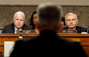 Senate Armed Services Committee Chairman Sen. John McCain, R-Ariz., left, and the committee's rankings member Sen. Jack Reed, D-R.I., question Army Lt. Gen. John Nicholson Jr., center, on Capitol Hill in Washington, Thursday, Jan. 28, 2016, during the committee's hearing on Nicholson's nomination to become the next top American commander in Afghanistan. (AP Photo/Alex Brandon)