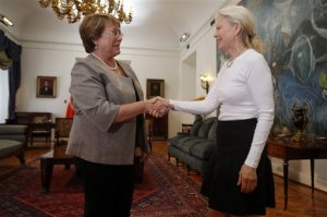 Kristine McDivitt Tompkins, widow of late American conservationist Doug Tompkins, left, shakes hands with Chile's President Michelle Bachelet at La Moneda Palace in Santiago, Chile, Thursday, Jan. 21, 2016. McDivitt Tompkins said that since her husband died last month while kayaking in South America's Patagonia region at age 72, she has been working non-stop to permanently protect from future development the millions of acres they acquired over a quarter-century. (AP Photo/Luis Hidalgo)