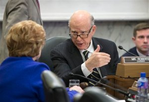 Senate Agriculture Committee Chairman Sen. Pat Roberts, R-Kansas, right, talks to the committee's ranking member Sen. Debbie Stabenow, D-Mich., on Capitol Hill in Washington, Wednesday, Jan. 20, 2016, as the panel voted to approve new measures to set fat, sugar and sodium limits in school lunches. (AP Photo/J. Scott Applewhite)