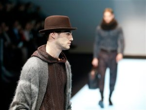 A model wears a creation for Giorgio Armani men's Fall-Winter 2016-2017 collection, part of the Milan Fashion Week, unveiled in Milan, Italy, Tuesday, Jan. 19, 2016. (AP Photo/Antonio Calanni)