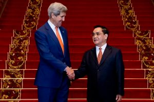 U.S. Secretary of State John Kerry, left, shakes hands with Lao Prime Minister Thongsing Thammavong after their meeting at the Prime Minister's Office in Vientiane, Laos, Monday, Jan. 25, 2016. Kerry is in Laos on the third leg of his latest round-the-world diplomatic mission, which will also take him to Cambodia and China. (AP Photo/Jacquelyn Martin, Pool)