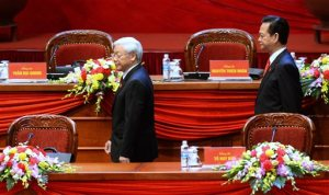 Vietnam Communist Party General Secretary Nguyen Phu Trong, left, and Prime Minister Nguyen Tan Dung walk on the podium the opening ceremony of the Communist Party of Vietnam's 12th Congress in Hanoi, Vietnam Thursday, Jan. 21, 2016. Vietnam's ruling Communist Party Thursday opened an eight-day congress to name the country's new set of leaders, who will determine the pace of critical economic reforms, the fight against corruption and relations with key trading allies, China and the United States. (Hoang Dinh Nam/Pool Photo via AP)
