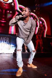 FILE - In this Dec. 4, 2015, file photo, Kendrick Lamar performs at Power 106's Cali Christmas 2015 in Inglewood, Calif. The Recording Academy announced Wednesday, Jan. 20, 2016, that leading nominee Kendrick Lamar will perform at the Grammy Awards on Feb. 15. (Photo by John Salangsang/Invision/AP, File)