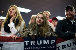 Supporters listen as Republican presidential candidate Donald Trump speaks during a campaign event, Wednesday, Jan. 20, 2016, in Norwalk, Iowa. (AP Photo/Evan Vucci)
