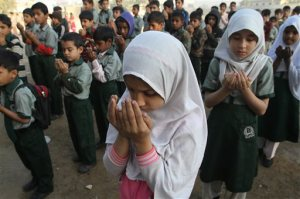 Pakistani students pray for the victims of the Bacha Khan University, at a local school in Karachi, Pakistan, Thursday, Jan. 21, 2016. Pakistan observed a day of mourning Thursday after a deadly attack by Islamic militants who stormed a northwestern university the day before, gunning down students and teachers and spreading terror before the four gunmen were slain by the military. (AP Photo/Fareed Khan)