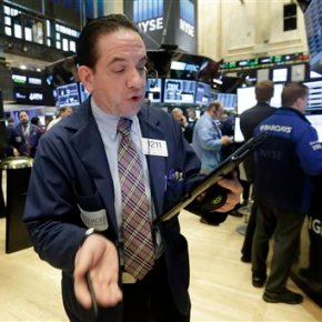 Stocks wobble as investors hope for cuts in oil production