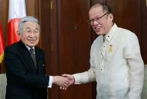 Philippines President Benigno Aquino III, right, greets visiting Japanese Emperor Akihito before a start of their meeting inside the presidential palace in Manila, Wednesday, Jan. 27, 2016. (Romeo Ranoco/Pool Photo via AP)