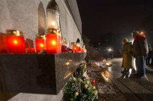 """Lithuanians lights candles on the eve of the 25th anniversary of the Day of the Defenders of Freedom """"Battle for the Freedom of Nations"""" in Vilnius, Lithuania, Tuesday, Jan. 12, 2016. Lithuanians will mark the anniversary of the Soviet crackdown on Wednesday, Jan 13, when 25 years ago Soviet special forces lay siege to the Vilnius TV tower. Fourteen people died in that siege and hundreds were wounded. (AP Photo/Mindaugas Kulbis)"""