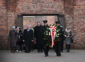 Soldiers hold a wreath at the former Auschwitz Nazi death camp in Oswiecim, Poland, Wednesday, Jan. 27, 2016, on  the International Holocaust Remembrance Day that marks the liberation of the Auschwitz Nazi death camp on Jan. 27, 1945. (AP Photo/Czarek Sokolowski)
