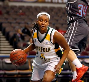 FILE - In this March 9, 2015, file photo, Norfolk State's Amber Brown moves the ball againstt Delaware State during a first round game at the Mid-Eastern Athletic Conference NCAA college women's basketball tournament in Norfolk, Va. A week ago, Amber Brown was a junior forward and sometimes starter on the Norfolk State women's basketball team. Now, she's laying in a hospital bed fighting for her life. (The' N. Pham /The Virginian-Pilot via AP, File)
