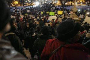 Protestors rally outside of the state Capitol during Michigan Gov. Rick Snyder's State of the State address on Tuesday, Jan. 19, 2016, in Lansing, Mich. With the water crisis gripping Flint threatening to overshadow nearly everything else he has accomplished, the Republican governor again pledged a fix Tuesday night during his annual State of the State speech. (Sean Proctor/The Flint Journal-MLive.com via AP) LOCAL TELEVISION OUT; LOCAL INTERNET OUT; MANDATORY CREDIT