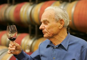 FILE - In this Thursday, May 19, 2005 file photo, Peter Mondavi samples a glass of Cabernet Sauvignon out of the barrel at the Charles Krug Winery in St. Helena, Calif. On Monday, Feb. 22, 2016, a winery board member said Mondavi, a wine country innovator who led his family's Charles Krug Winery through more than a half-century of change died Saturday, Feb. 20, 2016. He was 101. (AP Photo/Eric Risberg, File)