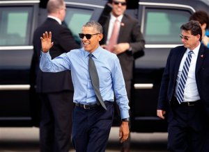 President Barack Obama walks over to the crowd before departing on Air Force One at Moffett Federal Airfield Thursday, Feb. 11, 2016, in Mountain View, Calif. Obama will fly to Los Angeles for more DNC fund raisers, as well as a appearance on comedian Ellen DeGeneres' show. (AP Photo/Tony Avelar)