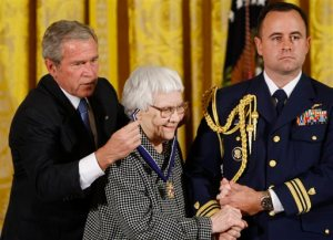 """FILE - In this Nov. 5, 2007 file photo, President Bush, left, presents the Presidential Medal of Freedom to author Harper Lee, center, during a ceremony  in the East Room of the White House in Washington. Lee, the elusive author of best-seller """"To Kill a Mockingbird,"""" died Friday, Feb. 19, 2016, according to her publisher, Harper Collins. She was 89. (AP Photo/Gerald Herbert, File)"""