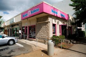 FILE - This 2008 file photo shows the Baskin-Robbins shop in Honolulu where President Barack Obama once worked.  Obama says his unglamorous first job scooping ice cream as a teenager taught him valuable lessons about responsibility and hard work.  (AP Photo/Marco Garcia)