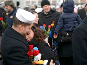 U.S. Navy Petty Officer 3rd Class Izaak Vaszquez and his wife Andrea embrace on the pier when the navy attack submarine USS Missouri (SSN 780) returns to the Navy Submarine Bast in Groton, Conn., Friday, Feb. 12, 2016 following a six-month deployment to the European Command area of responsibility. The Missouri, the seventh sub in the Virginia-class, made port calls in Faslane, Scotland, Rota, Spain and Brest, France during the deployment. (Sean D. Elliot/The Day via AP)  MANDATORY CREDIT