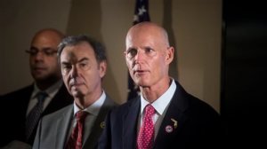 Florida Gov. Rick Scott, right, holds a press conference on Thursday, Feb. 4, 2016, at the at the Hillsborough County Health Department after his decision to declare a state of emergency in five counties affected by the Zika virus. Scott explains his plan moving forward and the risk of pregnant women contracting the virus. (Zack Wittman/The Tampa Bay Times via AP)