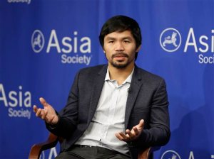 """FILE - In this Oct. 12, 2015, file photo, Manny Pacquiao takes questions at the Asia Society in New York. Boxing star Pacquiao has created a firestorm in his home country after saying people in same-sex relationships """"are worse than animals."""" Pacquiao, who is running for a Philippine Senate seat, made the remark in a video posted Monday, Feb. 15, 2016, on local TV5's election site. He also said animals are better than people in same-sex relationships because they recognize the difference between males and females. (AP Photo/Seth Wenig, File)"""