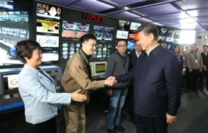 """In this photo released by China's Xinhua News Agency, Chinese President Xi Jinping, right, shakes hands with staff members at the control room of China Central Television (CCTV) in Beijing, Friday, Feb. 19, 2016. Chinese President Xi Jinping made a rare, high-profile tour of the country's top three state-run media outlets Friday, telling editors and reporters they must pledge absolute loyalty to the party and closely follow its leadership in """"thought, politics and action."""" (Ma Zhancheng/Xinhua via AP) NO SALES"""