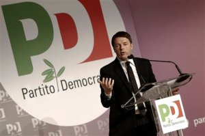 Italian premier Matteo Renzi delivers a speech during the national meeting of the Democratic Party in Rome, Italy,  Feb. 21, 2016. Renzi has has told his squabbling democrats that the government might consider resorting to a confidence vote to hasten approval of the law that will allow civil unions, but not marriage, for gay couples. (Giuseppe Lami/ANSA via AP)