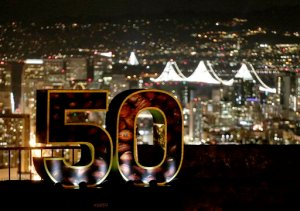 A Super Bowl 50 sign stands in a park overlooking San Francisco Wednesday, Feb. 3, 2016. The Denver Broncos play the Carolina Panthers in the NFL Super Bowl 50 football game Sunday, Feb. 7, 2015, in Santa Clara, Calif. (AP Photo/Charlie Riedel)
