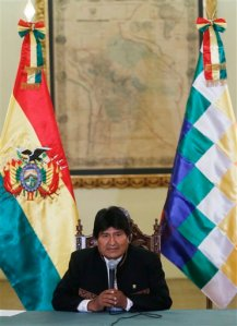 Bolivia's President Evo Morales speaks during a press conference at the government palace in La Paz, Bolivia, Monday, Feb. 29, 2016. Morales talked about Grabriela Zapata, his former lover who was working as a high-ranking executive at a Chinese firm, and who was arrested Friday 26. She has been part of a probe into alleged influence trafficking involving hundreds of millions of dollars in government contracts. (AP Photo/Juan Karita)