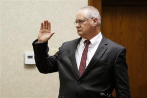 FILE - In this Feb. 15, 2016, file photo, Gatlinburg, Tenn., Detective Rodney Burns is sworn in as a witness before Judge Robert Philyaw during a preliminary hearing in Chattanooga for Ooltewah High School officials accused of failing to report a sexual assault. The teen's injuries outraged the Chattanooga prosecutor: Police said three older members of the basketball team shoved a pool cue into the boy's rectum, causing injuries that required emergency surgery, while hazing him and three other teammates on a trip to a tournament. But the detective from Gatlinburg, where the boy was injured, testified the case was overblown in the media. The jarring disconnect between views of the attack ignited an unusual public dispute between law enforcement agencies. (Dan Henry/Chattanooga Times Free Press via AP, File) THE DAILY CITIZEN OUT; NOOGA.COM OUT; CLEVELAND DAILY BANNER OUT; LOCAL INTERNET OUT; MANDATORY CREDIT
