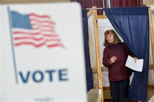 Melanie Harrison, from Winchester, N.H., exits the voting area at a Winchester, N.H. polling station during the New Hampshire primary on Tuesday, Feb. 9, 2016. (Kristopher Radder/The Brattleboro Reformer via AP)