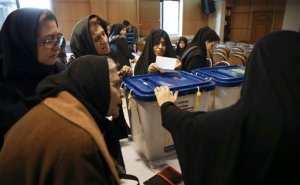 Iranian women gather at a polling station to vote for the parliamentary and Experts Assembly elections in central Tehran, Iran, Friday, Feb. 26, 2016. Iranians were voting on Friday in parliamentary elections, the country's first since its landmark nuclear deal with world powers last summer. At the same time as parliamentary elections, Iranians are also voting for the Assembly of Experts, a clerical body empowered to choose or dismiss the country's supreme leader. (AP Photo/Vahid Salemi)