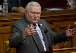 Poland's former president and Solidarity founder Lech Walesa delivers a speech during a special session of Venezuela's National Assembly, in Caracas, Venezuela, Thursday, Feb. 18, 2016. Walesa, the icon of Poland's successful struggle to topple communism and the 1983 Nobel Peace Prize laureate, has previously acknowledged signing a commitment to be an informant, but has insisted he never acted on it. In 2000 he was cleared by a special court, which said it found no evidence of collaboration. (AP Photo/Fernando Llano)