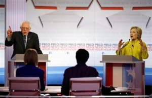 Democratic presidential candidates, Sen. Bernie Sanders, I-Vt, and Hillary Clinton argue a point during a Democratic presidential primary debate at the University of Wisconsin-Milwaukee, Thursday, Feb. 11, 2016, in Milwaukee. (AP Photo/Morry Gash)