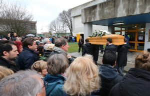 FILE - In this Friday, Feb. 12, 2016 file photo, The coffin of Giulio Regeni arrives at the church for his funeral service in Fiumicello, Northern Italy. Egypt on Monday, Feb. 15, 2016 denied reports that an Italian doctoral student doing research in Cairo was arrested shortly before his death and said an investigation into Regeni's killing is continuing with full Italian collaboration. (AP Photo/Paolo Giovannini, File)