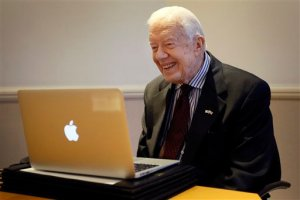Former US President  Jimmy Carter listens during a video interview with the Associated Press via a laptop at a hotel in London, Tuesday, Feb. 2, 2016. Carter says that Guinea worm disease may soon be eradicated, which would be the most exciting accomplishment of his career, although progress is hampered by ongoing conflict in Mali and South Sudan. Carter has led a campaign since 1986 through his foundation, the Carter Center, to rid the world of the once-widespread disease. With only 22 cases worldwide last year, they may now be on the cusp of wiping it out forever. (AP Photo/Kirsty Wigglesworth)