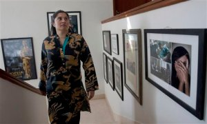 In this Tuesday, Feb. 2, 2016 photo, Pakistan's Oscar winning filmmaker, Sharmeen Obaid-Chinoy arrives at her office in Karachi, Pakistan. Obaid-Chinoy is nominated for a second Oscar for her moving story of a teenage girl shot and dumped into a river because she married a man of her choosing. (AP Photo/Shakil Adil)