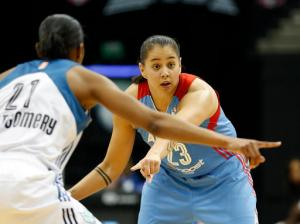 FILE - In this July 31, 2015 file photo, Atlanta Dream guard Shoni Schimmel (23) tries to set up a play against Minnesota Lynx guard Renee Montgomery (21) during a WNBA basketball game in Minneapolis. A court-side confrontation has led the Santa Fe, N.M., Indian School to fire their two basketball coaches, both the parents of Shoni Schimmel. They say racial remarks set off the dispute. The school's varsity head coach Ceci Moses, and her husband and assistant coach Rick Schimmel were let go Sunday, Feb. 21, 2016, following a game the previous week against St Michael's High School. (AP Photo/Stacy Bengs, File)