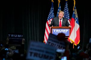 FILE - In this Feb. 21, 2016 file photo, Republican presidential candidate Donald Trump speaks at a campaign event in Atlanta. With its red, white and blue bunting, patriotic slogans and ubiquitous country songs, the presidential campaign marching through South Carolina and Nevada seems like an all-American affair. But it holds familiar overtones to Europeans watching anxiously from abroad. (AP Photo/David Goldman, File)