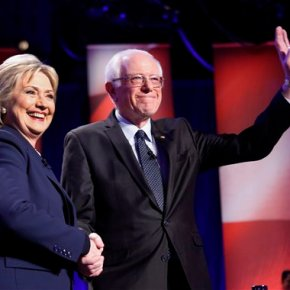 Dems up the decibels in NH debate; Wall Street a commonfoe