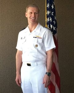 U.S. Navy Vice Adm. Joseph Aucoin, commander of the Navy's 7th Fleet, poses for a photo in Sydney Monday, Feb. 22, 2016. The commander of the U.S. Navy's 7th Fleet said Monday that he is wary of the situation in the South China Sea being painted as a battle between the United States and China, but added the presence of a Chinese missile system on a disputed island will not stop the U.S. military from flying over the region. (AP Photo/Kristen Gelineau)