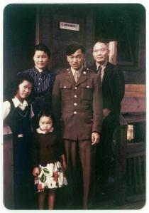 In this 1945 photo provided by Alice Tanaka Hikido, members of the Tanaka family stand together at the Minidoka Japanese internment camp in Jerome, Idaho, where they were held in forced incarceration during World War II. Alice Tanaka Hikido, left, and her sister, Mary Tanaka Abo, who was the child in the foreground, participated in a Feb. 19, 2016, ceremony at Joint Base Elmendorf-Richardson, Alaska, that was held to remember the forced incarceration of more than 200 Alaskans, as well unveil the results of a study about a little-known Japanese internment camp that was erected there during World War II. Also pictured are Nobu Tanaka, back left, John Tanaka, in uniform second from right, standing next to Shonosuke Tanaka. (Alice Tanaka Hikido via AP)