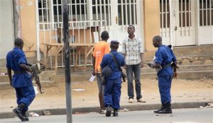 Police arrest a man following grenade attacks in the capital Bujumbura, Burundi Wednesday, Feb. 3, 2016. Burundian police say at least eight people have been wounded in a series of grenade attacks in the center of the capital. (AP Photo)