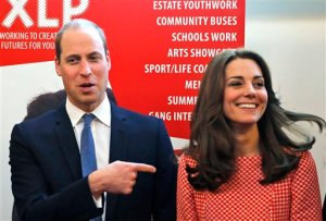 FILE - In this  Friday, March 11, 2016 file photo, Britain's Prince William and Kate Duchess of Cambridge smile as theyn visit the mentoring programme of the XLP project in London. The Duke and Duchess of Cambridge are embarking on what is seen as one of their most ambitious tours to date — taking in the Taj Mahal as well as visiting the Mumbai hotel targeted by gunmen in the 2008 attacks that killed 166 people. Prince William and his wife the Duchess of Cambridge will visit the monument of love, the Taj Mahal, during the tour to India and Bhutan from April 10-April 16, Kensington Palace said Tuesday, March 29. The visit should have special resonance for William because his mother, the late Princess Diana, was photographed there alone — an image that came to underscore the breakup of her marriage with Prince Charles. (AP Photo/Frank Augstein, file)
