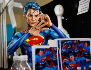 In this March 19, 2016 photo, Kay Pike transforms herself using body paint and latex into Superman while live streaming at her home in Calgary, Alberta. The Canadian artist turns her body into different characters for an Internet audience. (Jeff McIntosh/The Canadian Press via AP) MANDATORY CREDIT
