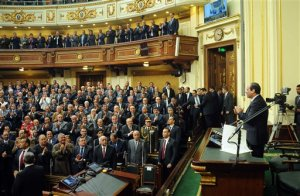 FILE - In this Saturday, Feb. 13, 2016 file photo provided by Egypt's state news agency MENA, Egyptian President Abdel-Fattah el-Sissi, addresses parliament in Cairo, Egypt.  El-Sissi reshuffled his government on Wednesday, March 23, 2016 naming nine new ministers and creating a new portfolio for business but leaving the key ministries of defense, foreign affairs or interior untouched. (MENA via AP, File)