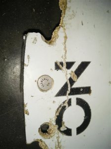 """In this Feb. 28, 2016 image provided by Blaine Gibson and the Australian Transport Safety Bureau (ATSB),  a piece of aircraft debris with the words """"NO STEP"""" is photographed after it was found washed up on a beach in Mozambique. Debris that washed up in Mozambique has been tentatively identified as a part from the same type of aircraft as the missing Malaysia Airlines Flight 370, a U.S. official said. (Blaine Gibson/ATSB via AP) MANDATORY CREDIT, NO SALES"""