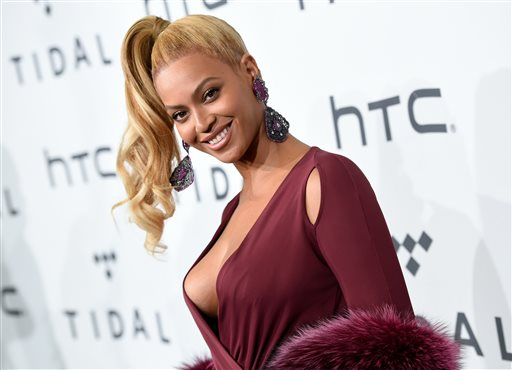 FILE - In this Oct. 20, 2015 file photo, singer Beyonce Knowles arrives at TIDAL X: 1020 Amplified by HTC in New York. Beyonce is launching an active wear line for women next month. The singer announced the 2016 spring/summer collection called Ivy Park on Thursday. It's a collaboration with Sir Philip Green and will be available April 14. (Photo by Evan Agostini/Invision/AP, File)